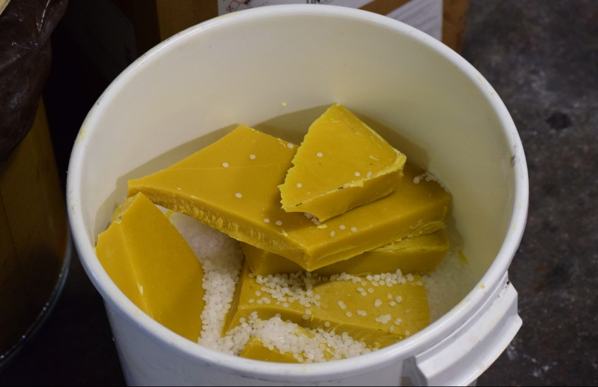 Beeswax and other waxes, soon to be melted and mixed in the reactor