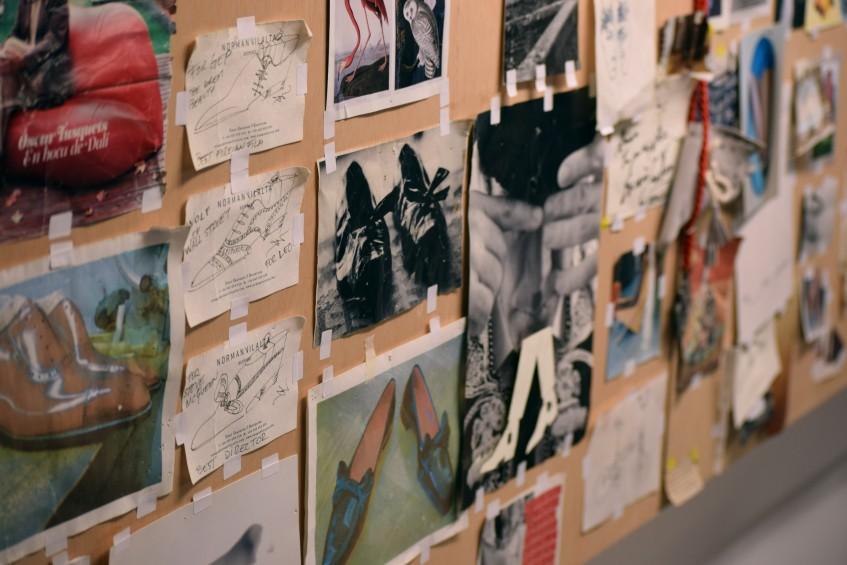 The workshop pinboard, full of inspirational photos and Norman's drawings