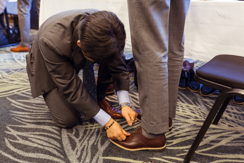 Hiro Yanagimachi in the process of fitting a pair of bespoke shoes