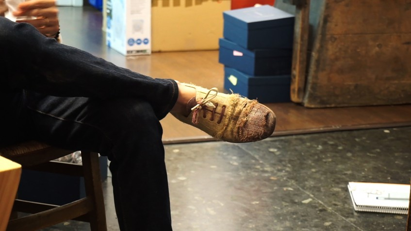 An alternative approach to beauty: these raffia palm fibre shoes are worn to the point of tearing, but Norman loves them just as much