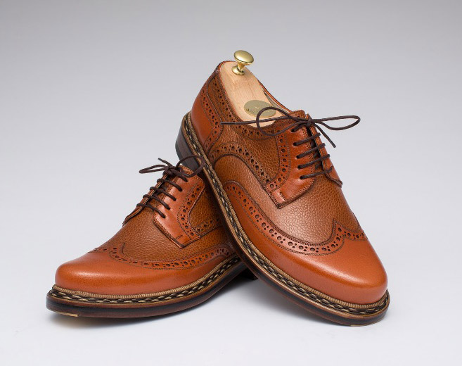 A traditional Budapester style shoe made up in tan grain and smooth leather.