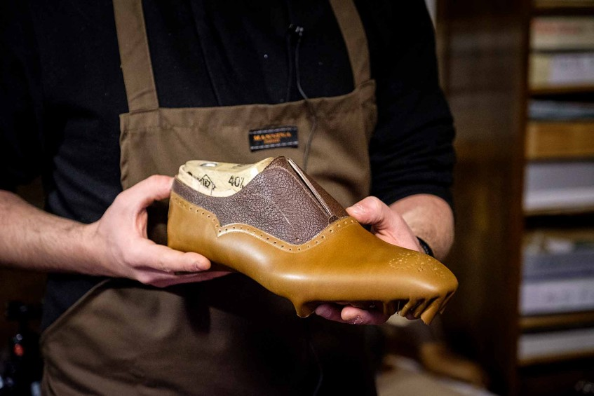 A two-tone bespoke Oxford shoe that has just been lasted by hand.