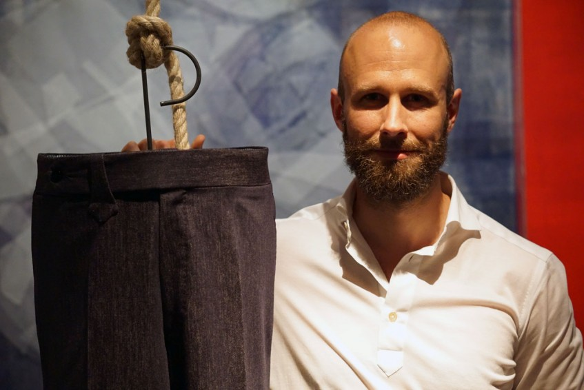 Simon Crompton and the trousers he designed with Pommella Napoli, at the Pommella Napoli party, second evening of Pitti